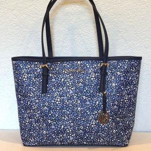 8309351a8748 Michael Kors Bags - Michael Kors Medium Travel Carryall Tote Floral